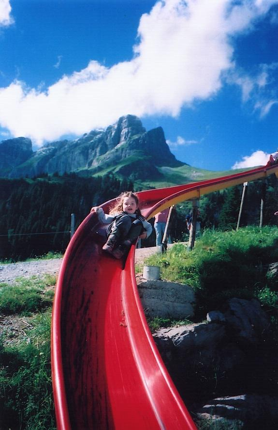 kid on slide (Braunwald, Switzerland, 2001)